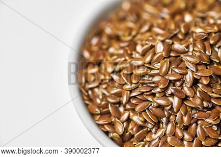 Flaxseed, Linseed In Bowl, Isolated. Bunch Of Linum Usitatissimum - Common Flax Seeds. Healthy Veget