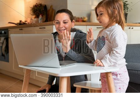 Mother And Child At Home. Video Chat. Family Doctor Online. Social Distance. Distance Learning, Home