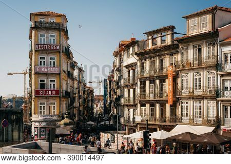 Porto, Portugal - September 27, 2018: Traditional Portuguese House, With Windows And Ornate Metal Ba