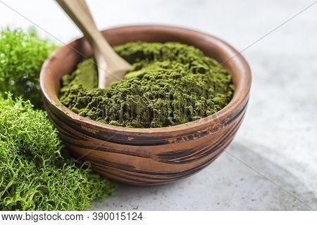 Green Powder Chlorella, Spirulina On Gray Concrete Background. Concept Dieting, Detox, Healthy Super