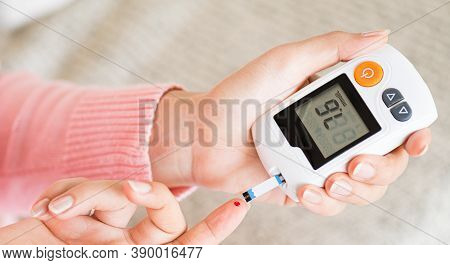 World Diabetes Day Concept. Close Up Hands Holding Lancing Device With Blood To Checking Blood Sugar