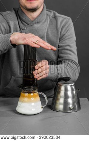 Faceless Man Of The Barista Brews Coffee By A Special Method Of Filtration.