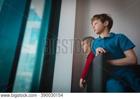 Boy And Girl Staying Home Due To Social Distancing, Kids Looking At The Window