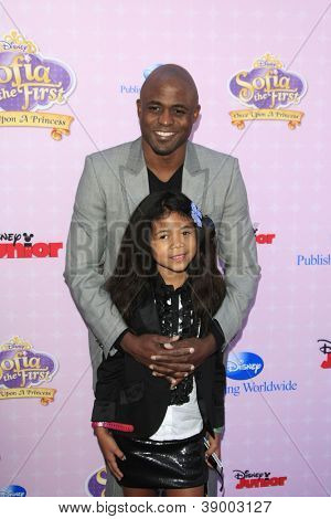 BURBANK - NOV 10: Wayne Brady, daughter Maile at the premiere of Disney Channels' 'Sofia The First: Once Upon a Princess' at Walt Disney Studios on November 10, 2012 in Burbank, California