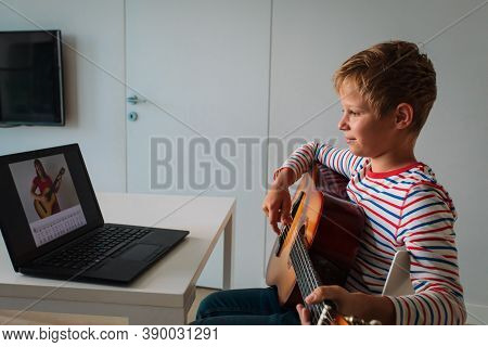 Happy Kid Having Guitar Lesson Online, Distant Learning