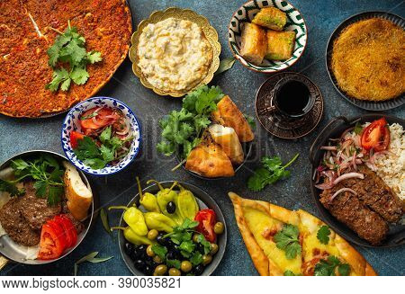 Traditional Turkish Food, Assorted Dishes And Mezze Appetizers On Rustic Background From Above. Pide