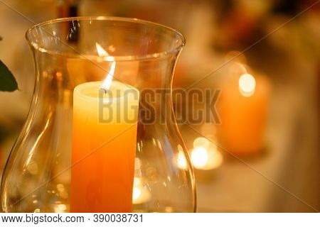 Burning Candles In Tall Glass Vases Standing On The Table, Candles In Glass Vases, Wax Candle In A G