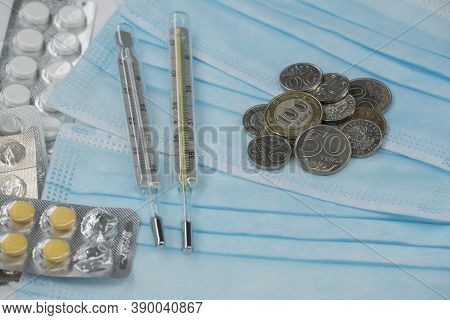 Thermometer, Tablet, Medical Mask And Tenge Money Are On The Table. Increase In The Price Of Medicin