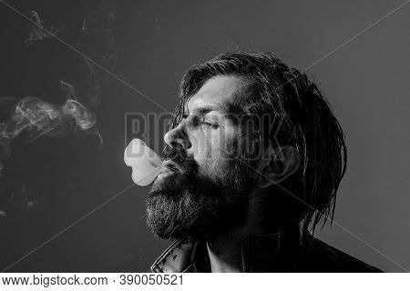 Portrait Of Handsome Man With Cigarette. Cigarette Smoke. Bearded Man Smoking. Tobacco. Smoking Hips