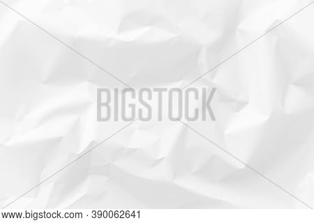A Clean, Crumpled Sheet Of White Or Milky Paper. Light Texture Of A Crumpled Paper Sheet. Background