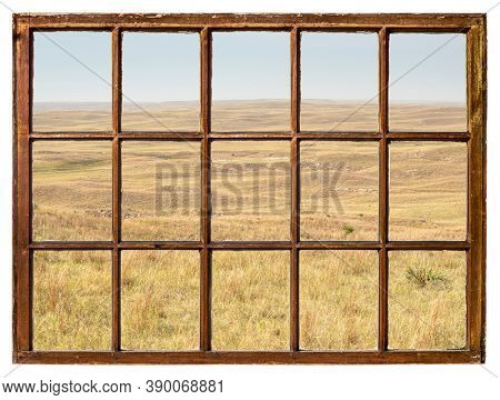 midday scenery of Nebraska, early fall scenery with haze from Colorado wildfires as seen from a vintage sash window
