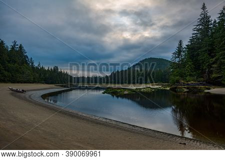 The Beautiful San Josef River On A Cloudy Morning With Reflection In Cape Scott Provincial Park On V