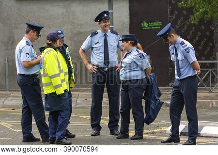 Nicosia, Cyprus-october 28, 2019: A Group Of Police Officers, Men And Women, Stand On A Blocked Stre