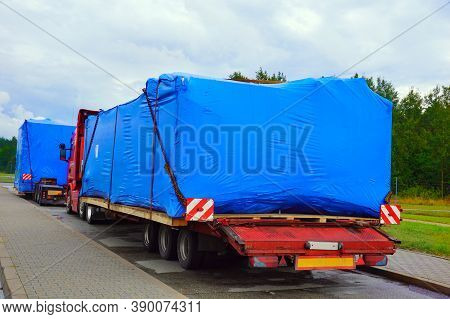 A Truck With A Special Semi-trailer For Transporting Oversized Loads. Oversize Load Or Exceptional C