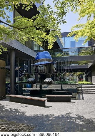 Seoul, South Korea - May 3, 2017: Modern architecture of the city. A giant sculpture of a dog in a blue hat in front of the facade of a modern building. Itaewon district