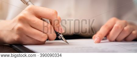 Businessman Signing Financial Contract And Hand Holding Pen Putting Signature After Reaching An Agre