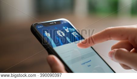 Bangkok, Thailand - October 20 , 2020 : Hand Is Pressing The Facebook Screen On Apple Iphone 11, Soc