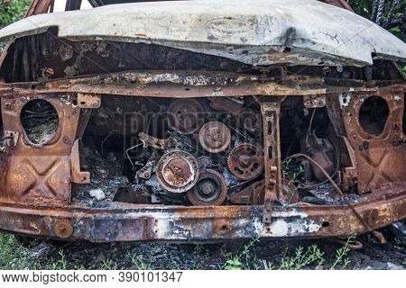 Burned Car. Consequences Of Car Accident. Damaged By Arson. Machine After A Fire.