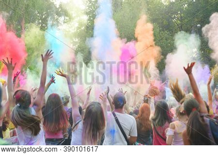 Holi Festival Of Color. Holi Colorful Festival Of Colored Paints Of Powders And Dust. People Covered