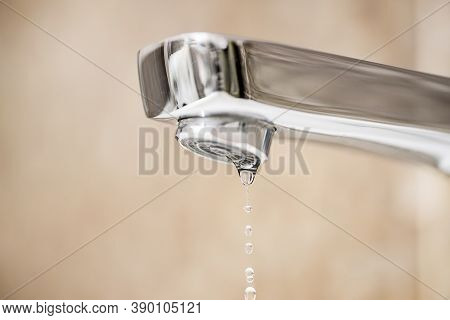 Water Tap And Drops Of Water. Water Tap With Dripping Waterdrop. Water Leaking, Saving.