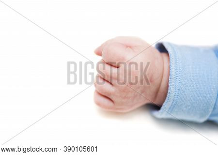 Close Up Of A Child\'s Fist On White Background. Clenched Fist - Hand Of Child, Baby Power. New Born