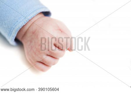 Close Up Of A Child's Fist On White Background. Clenched Fist - Hand Of Child, Baby Power. New Born
