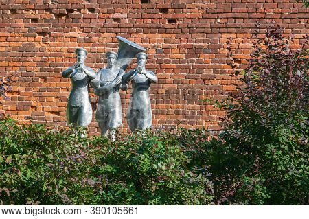 Russia, Yaroslavl, July 2020. Revolutionary Orchestra Made Of Stone Against A Background Of A Brick