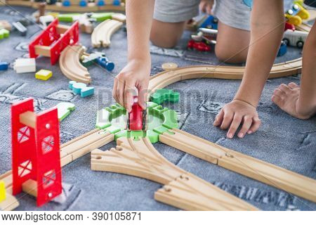 Children Playing With Wooden Train. Toddler Boy Play With Train And Cars. Educational Toys For Presc