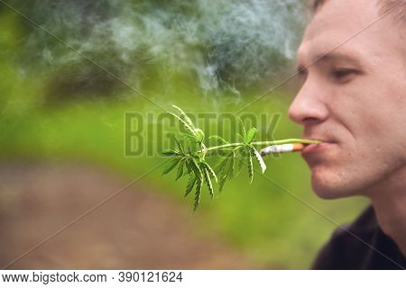 Hemp And Cigarette. Legalize Marijuana With A Human Mouth With A Joint Or Cigarette In Your Teeth. S
