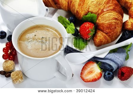 breakfast with coffee, croissant and fresh berries