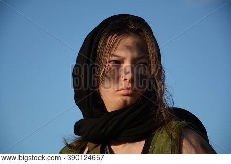 A Portrait  Of A Teenage Girl Militia Soldier In A Post Apocalyptic Desert Wasteland. Urban Combat A