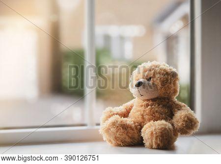 High Key Light Sad Teddy Bear Sitting Near Windowing Sunny Day, Lonely Brown Bear Sitting Alone At H