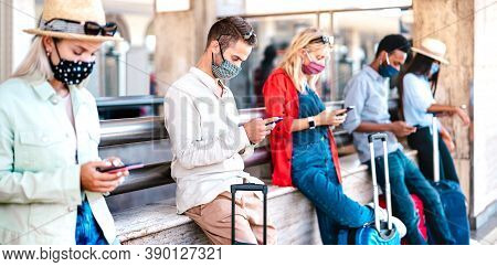 Multiracial Friends Wearing Face Mask Using Mobile Smart Phones - Young Millenial Checking Online Re