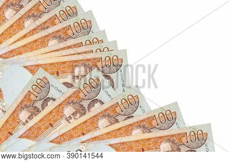 100 Dominican Peso Bills Lies Isolated On White Background With Copy Space Stacked In Fan Close Up