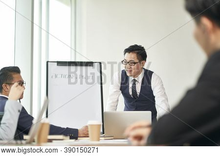 Young Asian Business Man Facilitating A Discussing During Team Meeting In Office