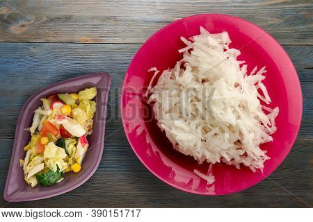 Daikon On Blue Grey Wooden Background. Daikon On Red Plate With Vegetarian Salad Top View