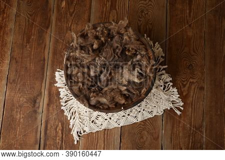 Newborn Photography Digital Background Prop. Wicker Basket With Brown Fur On A Wooden Background.