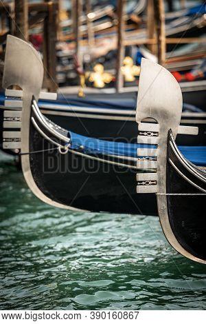 Venice, Close-up Of Two Gondola Prows, Typical Venetian Rowboat, Canal Grande, Unesco World Heritage