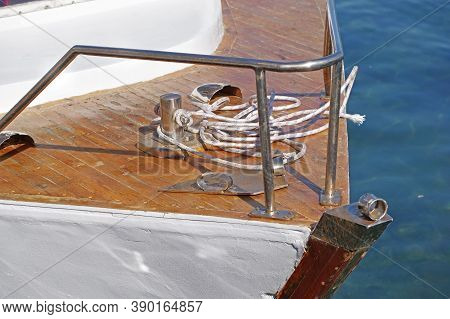 Metallic Pulley Block And Ropes On The Deck Of An Old Sailboat Ship