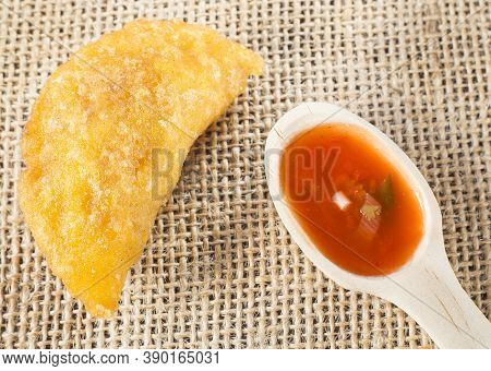 Colombian Empanada With Spicy Sauce - Text Space