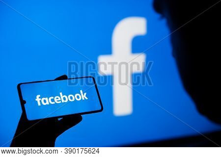 Wroclaw, Poland - Sep 16, 2020: Man Holding Smartphone With Facebook Mobile App On Screen, Facebook