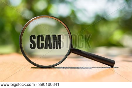 Scam Text On Magnifier Glass. Scam Alert Word Concept, A