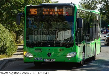 Bucharest, Romania - September 27, 2020: A Public Transport Bus Mercedes Citaro Hybrid Is Driven In