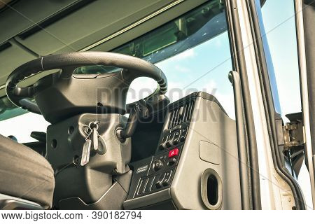 Underneath View Of Open Cab Interior Big Truck With Steering Wheel On Front