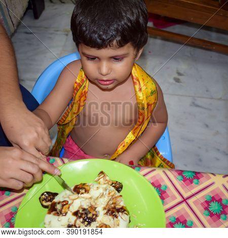 Cute Indian Kid Dressed Up As Little Lord Krishna On The Occasion Of Radha Krishna Janmastami Festiv
