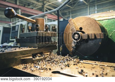 An Old Lathe And In The Background Is A Modern Cnc Lathe. Mechanical Lathe Stands In The Workshop