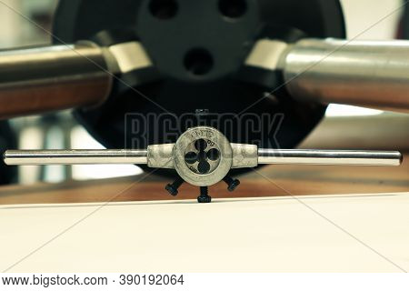 Thread-cutting Is A Tool That Cuts Threads On Bolts. Thread Cutter Close-up. Metalworking Of Parts A