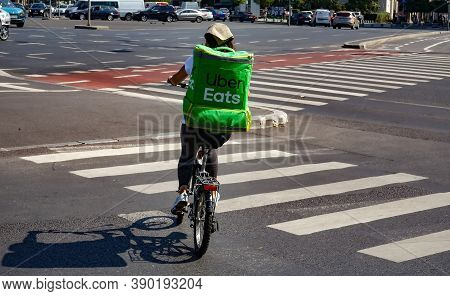 Bucharest, Romania - September 10, 2020: An Uber Eats Food Delivery Courier Delivers Food In Buchare