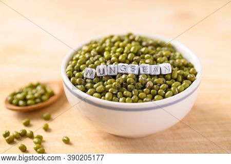 Mung Bean In A Bowl With Mung Bean Alphabet On Wooden Background