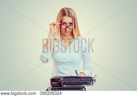 Skeptical Woman At Typewriter Looking At You Camera Doubtfully Isolated On Light Green Yellow Backgr